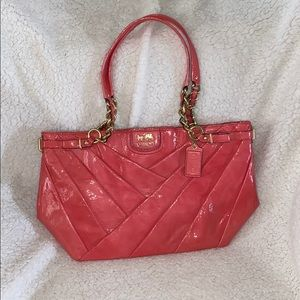 Hot pink coach purse with gold accents